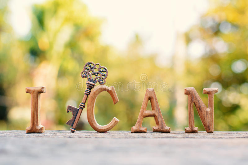 Alphabet wood. `I can` word on tree bokeh background, selective and soft focus stock photos