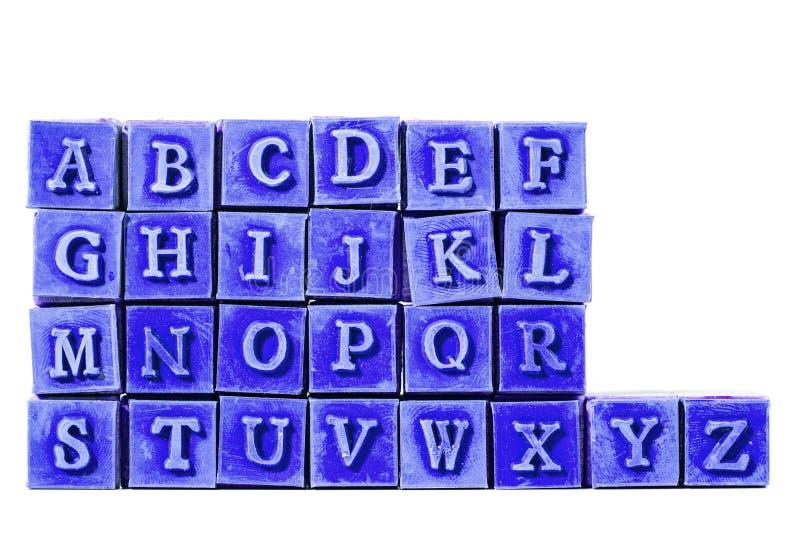 Alphabetbuchstabestempel stockfoto
