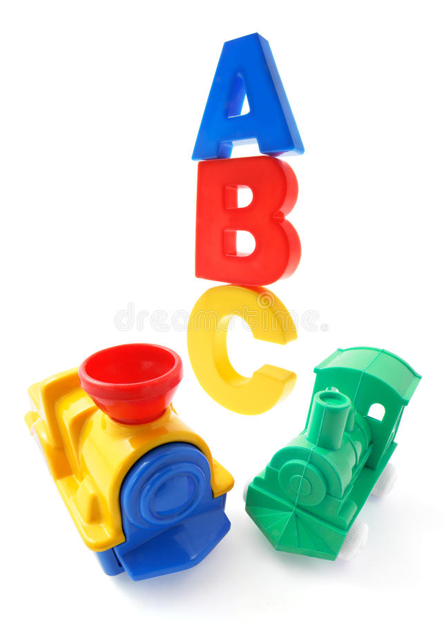 Alphabets and Plastic Toy Trains stock photos