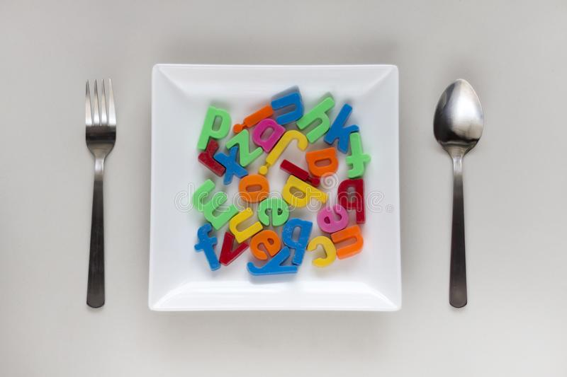 Alphabets in a plate. royalty free stock image