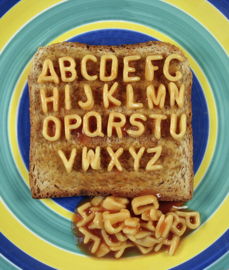 Alphabetti. The alphabet written with pasta shapes on toast - funny huh royalty free stock photo