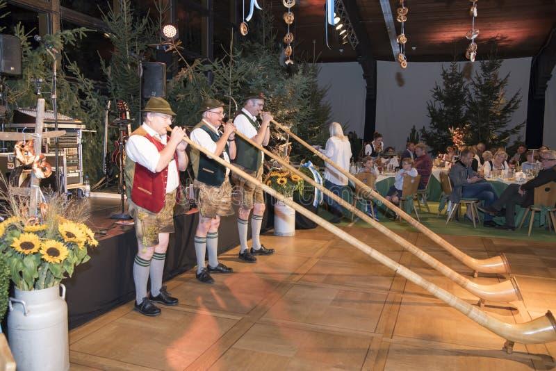 Alphorn blowers at Oktoberfest royalty free stock image