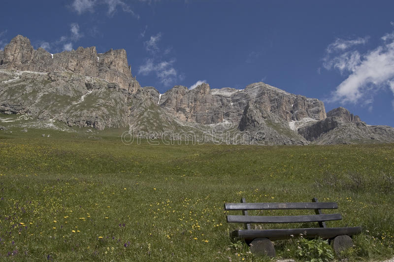 Alpine bench. Landscape and nature among alps, Italy royalty free stock photography
