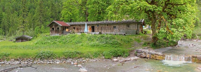 Alpine cabin in the bavarian alps. Farmed alpine cabin in the bavarian alps, river weissach royalty free stock photo