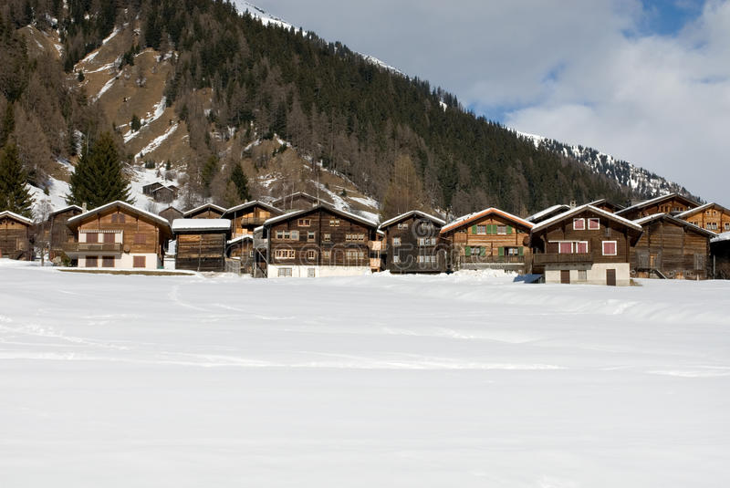 Alpine Chalets. In a small Swiss village royalty free stock image