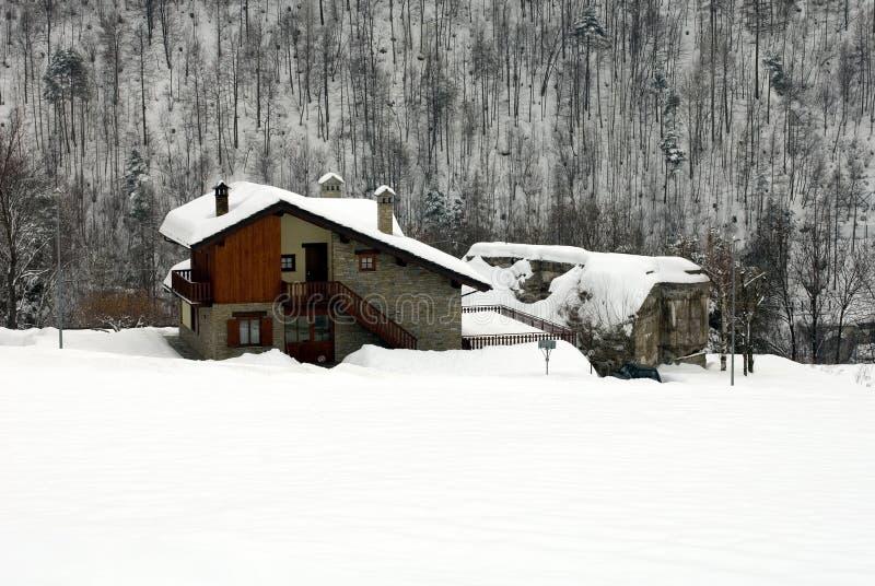 Alpine Chalets, Italy. Alpine chalets, after a heavy snowfall, Itay stock photo