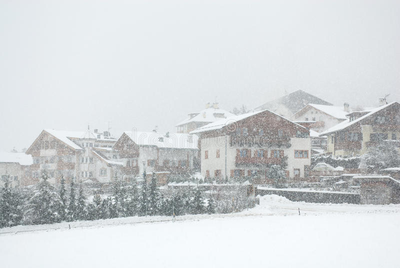 Alpine Chalets, Northern Italy. Chalets, during a snowstorm, in Mals, Northern Italy stock photo