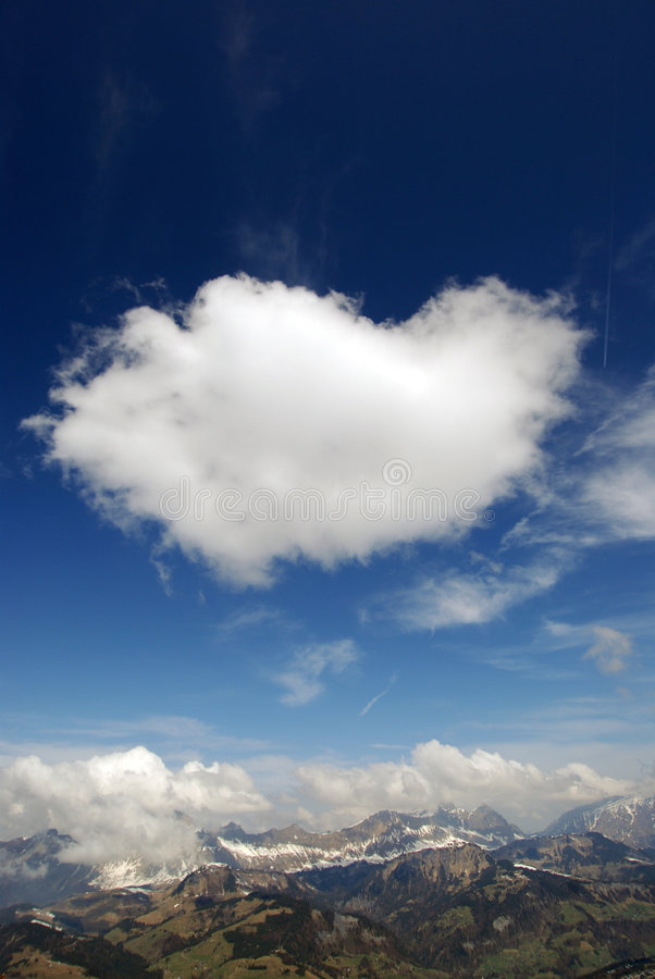 Alpine cloudburst. Massive, puffy clouds hovers over alps royalty free stock photo