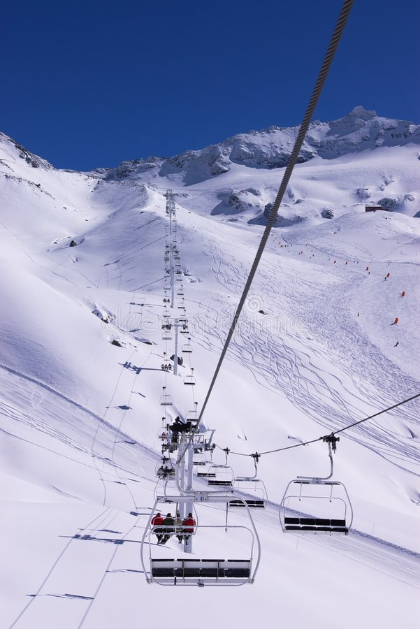 Alpine downhill slope: view from the lift stock photo