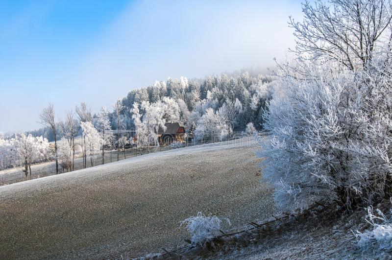 Alpine farm house covered with hoar frost, rime stock images