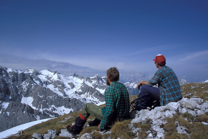 Alpine hikers. Hikers during break in the Alps, Austria royalty free stock photos