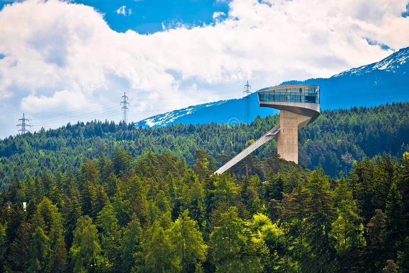 Alpine hills of Insbruck and olympic ski jump tower view stock images