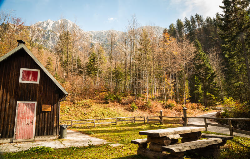 Alpine hut with a bench royalty free stock images