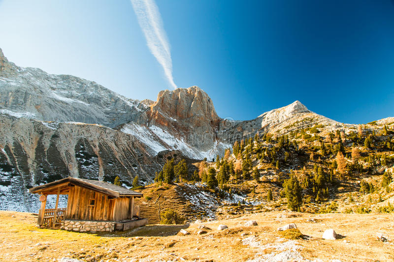 Alpine hut with a bench stock photo
