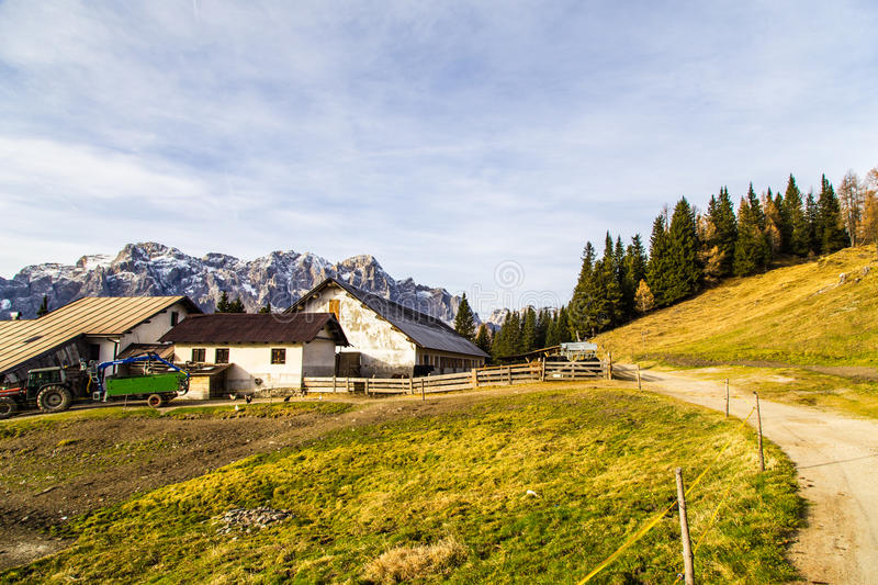 Alpine hut with a bench royalty free stock image