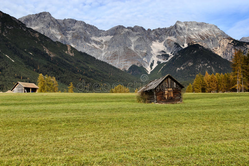 Alpine hut in mountain at rural fall landscape. Mieminger Plateau, Austria, Europe stock photography