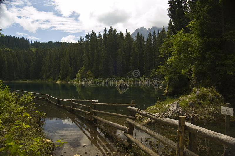 Alpine lake. Natural scenic on the alpine lake, dolomites alps, italy royalty free stock photo