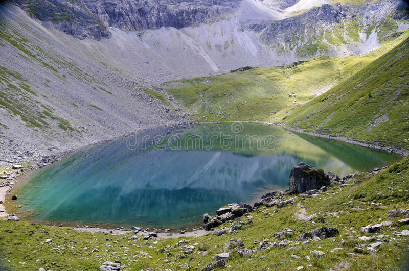 Alpine lake. Surrounded by mountains in Obertauern area, Austrian Alps, Europe stock image