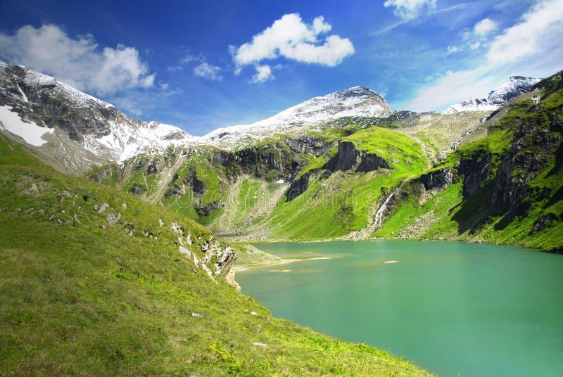 Download Alpine lake stock image. Image of cliffs, grass, majestic - 8468251