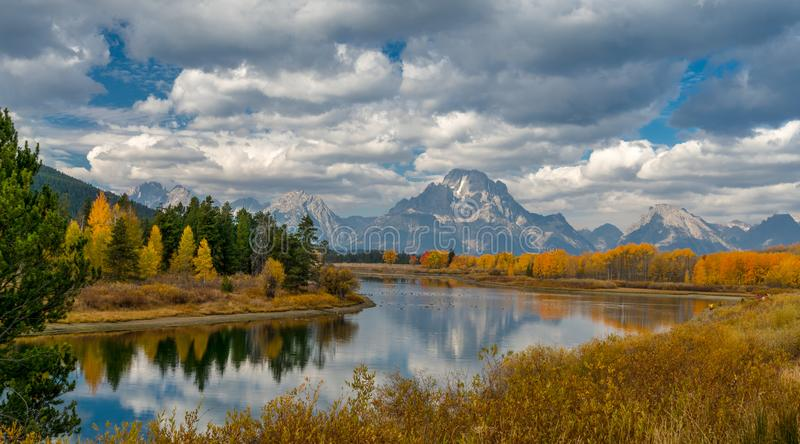 Alpine lake and colorful trees with reflection and mountain landscape royalty free stock image