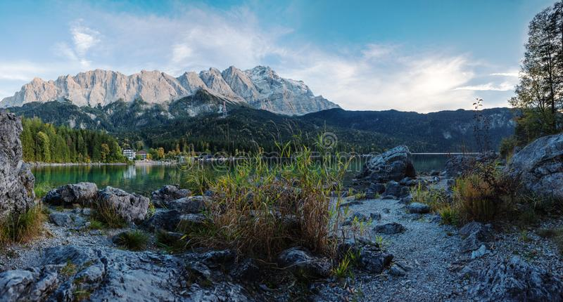Alpine lake eibsee and mountain range zugspitze in the evening stock images