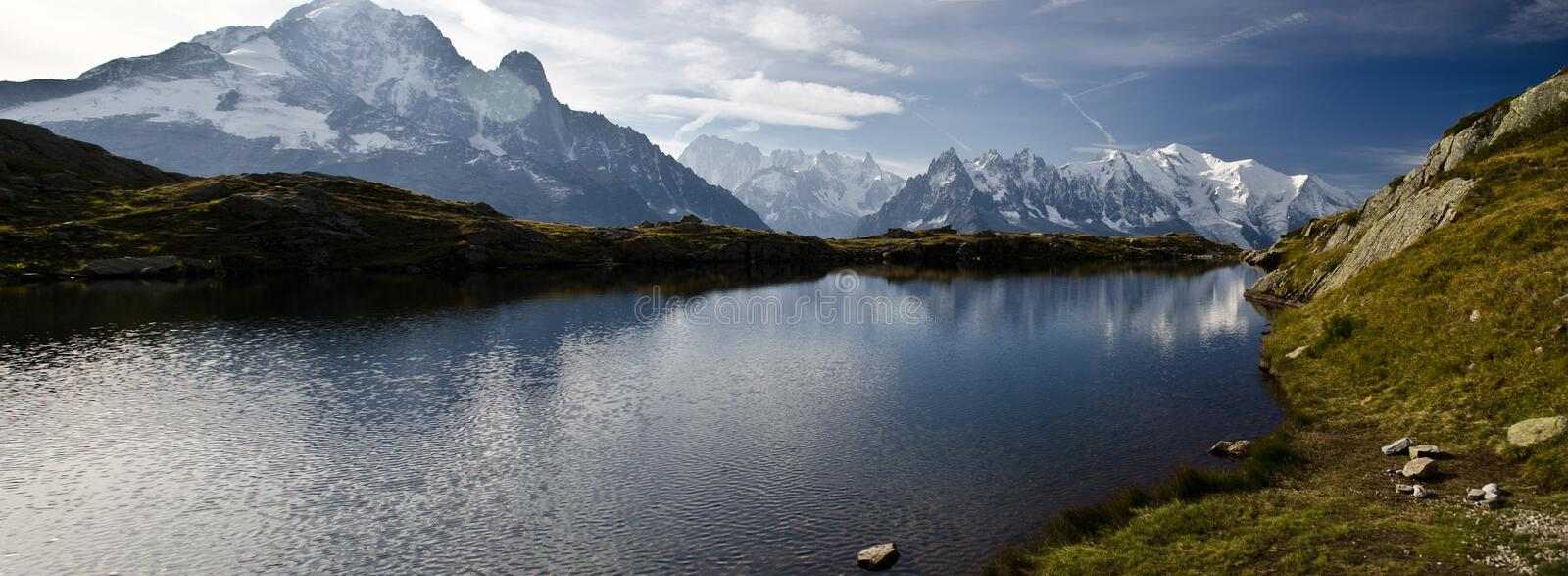 Alpine lake and mountains royalty free stock photography