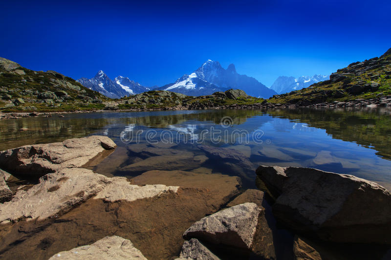 Alpine lake reflection in the French Alps