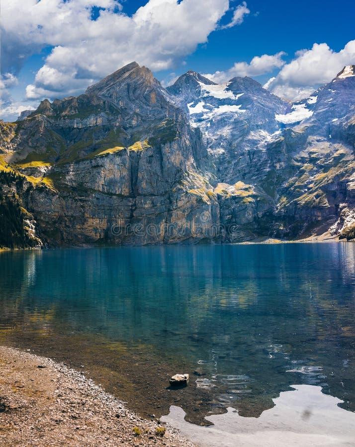 Alpine lake on sunny day stock photos