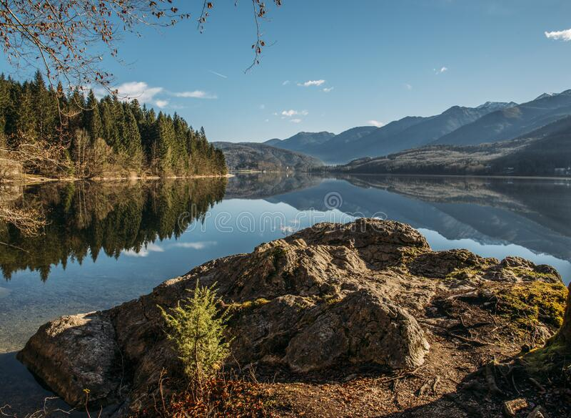 Alpine lake on sunny day stock photography