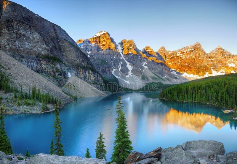 Alpine lakeside at sunset royalty free stock image