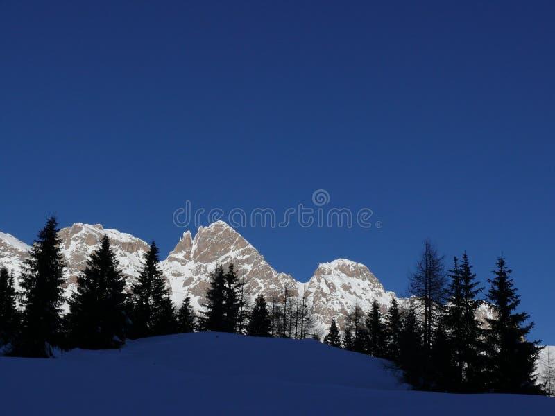 Alpine landscape of the Dolomites with snow. Trentino stock photo