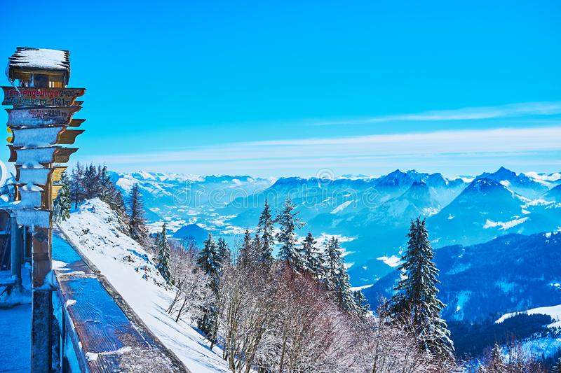 Alpine landscape with hiking signboard, Zwolferhorn, St Gilden, Salzkammergut, Austria. Watch spectacular Alpine landscape, covered with snow and surrounded by royalty free stock photography
