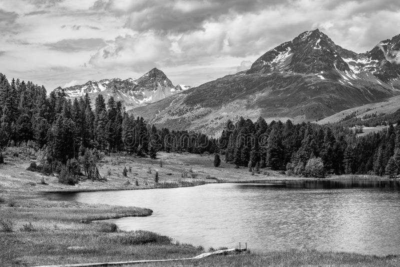Download alpine landscape with mountain lake in black and white fine art stock photo
