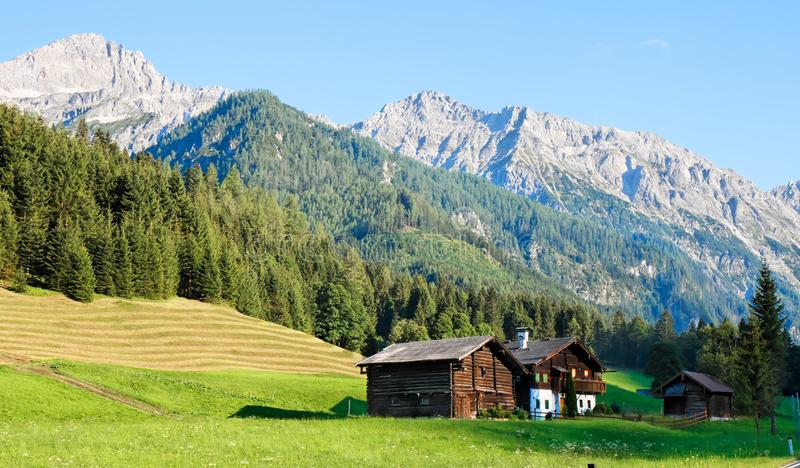 Alpine landscape of mountains and meadows royalty free stock photography