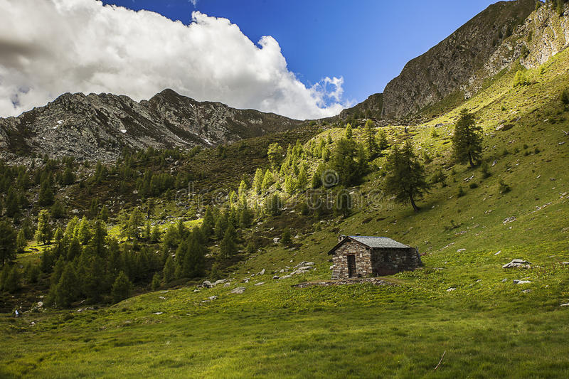Alpine landscape. With old stone house royalty free stock photography