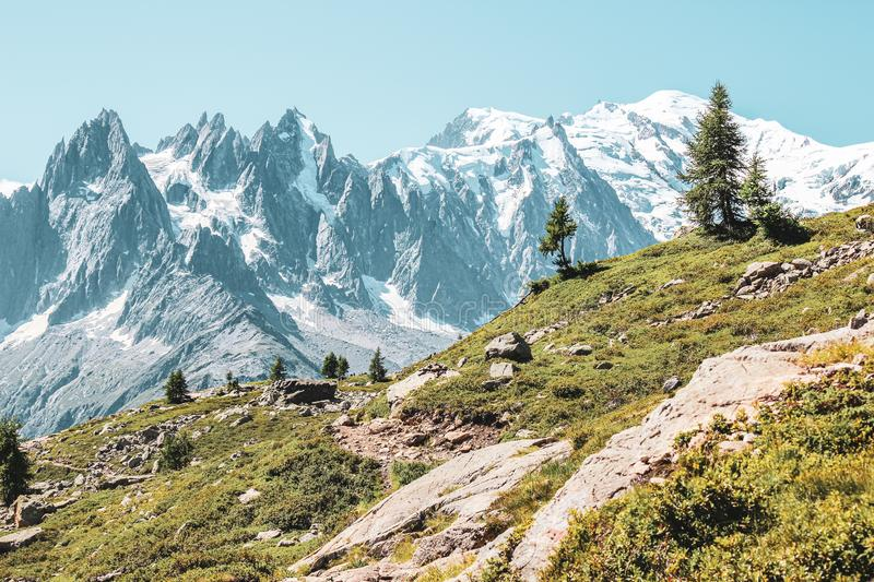 Alpine landscape with snow capped mountains including the highest mountain of Europe Mount Blanc. Photographed in late summer near royalty free stock images