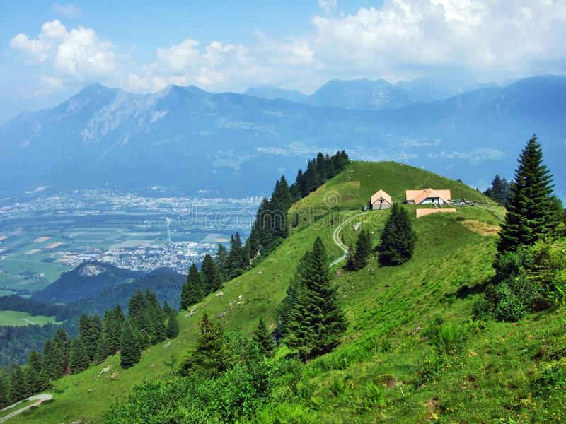 Alpine livestock farms and stables on the slopes of Alvier mountain in the Appenzell Alps mountain range. Canton of St. Gallen, Switzerland stock photography