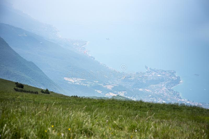 Alpine meadows with wild flowers on the summit of Monte Baldo in Italy. Monte Baldo, know since 1500 by the name of `Hortus Italiae`, is a treasure chest where royalty free stock photo