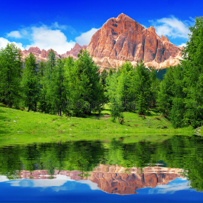 Alpine mountain lake. In sunny day royalty free stock photography