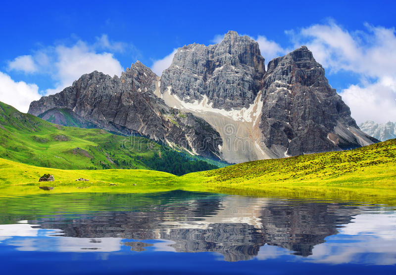 Alpine mountain lake. In sunny day stock images