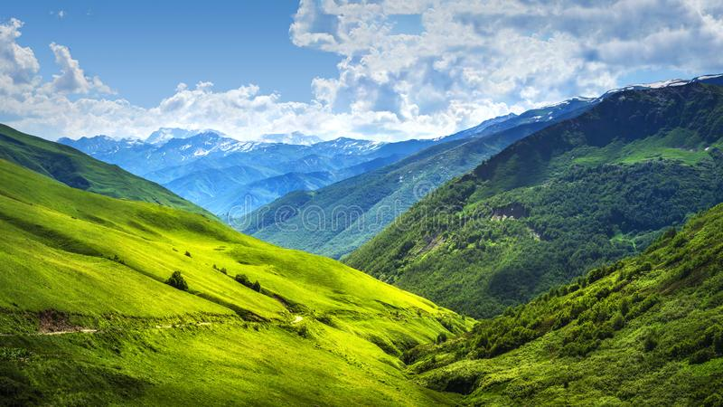 Alpine mountain landscape. Svaneti mountains ranges. Green grassy hills in Georgian highlands on sunny bright day. royalty free stock photo