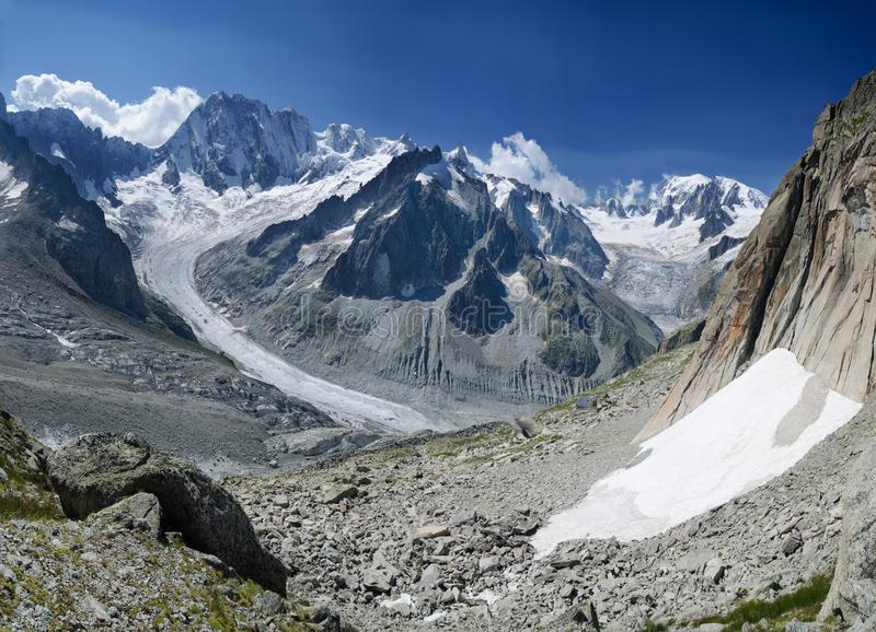 Alpine panorama with mountain peaks and glaciers. Peaks of Grandes Jorasses and Mont Blanc with the Leaschaux glacier in the Chamonix, French Alps royalty free stock image