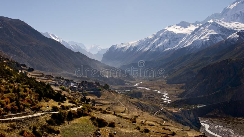 Alpine panorama of the village of Manang stock photography