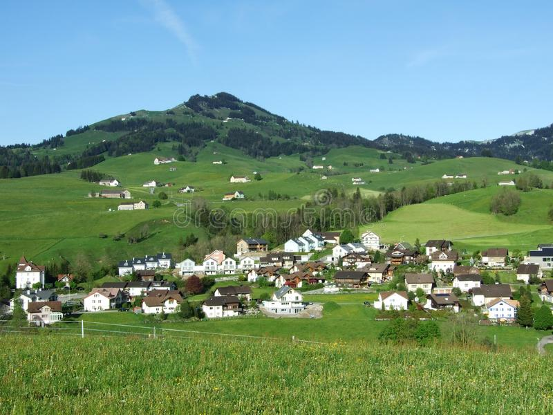 Alpine panorama of the villages and pastures of the Swiss stock photos