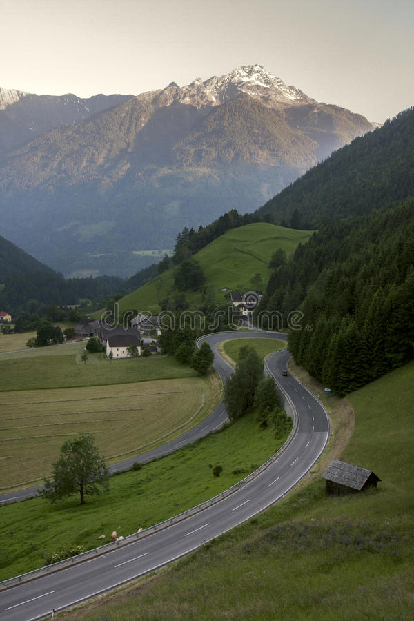 Alpine road in Austrian Alps. In spring with snowy peaks in the background, Mallnitz, Austria royalty free stock images