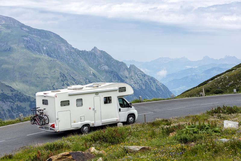 Alpine road, motorhome speeding, Eastern Alps. Motorhome speeding on alpine road, Eastern Alps royalty free stock images