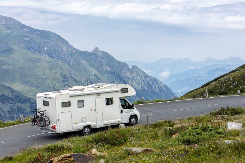 Alpine road, motorhome speeding, Eastern Alps royalty free stock images