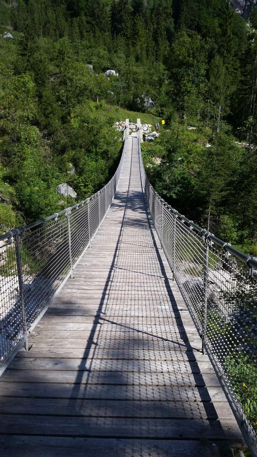 An alpine rope bridge on the trail near the Konigsee, Germany stock images