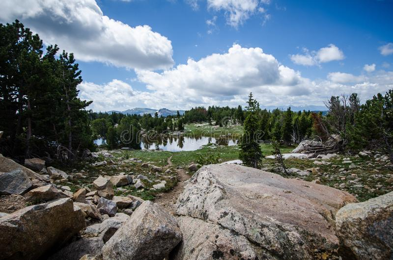 Alpine scenery with lake, trees, and rocks along the Beartooth Highway in Montana near Yellowstone National Park stock photo