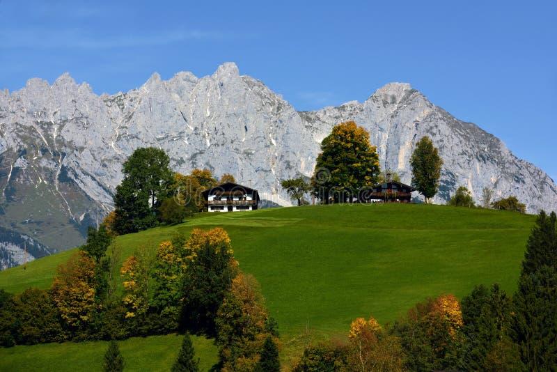Wilder Kaiser, Tirol, Austria. Alpine scenery with picturesque alpine houses under Wilder Kaiser mountains in Tirol - Austria stock photos